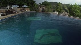 Swimming pool on top of a mountain in Paradise Park Farm Samui stock footage video. Koh Samui Island, Thailand - June 19, 2017: Swimming pool on top of a stock video