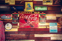 Koh Samui, Thailand – 30 june 2016: Vintage style old fashioned bar counter wooden wall with retro signs and signboards at cafe Royalty Free Stock Photography