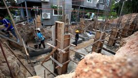 Koh Samui, Thailand 18 July 2014. Manual workers stock video footage
