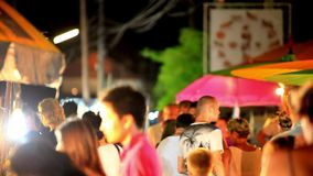 Koh Samui, Thailand 18 july 2014 Unidentified. Unidentified tourists walk along night street on Koh Samui. Thailand. 1920x1080 stock video footage