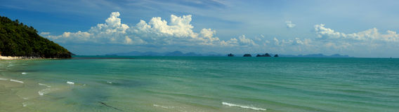 Koh Samui West Coast. A panorama view of the Koh Samui west coast with a cloudy blue sky royalty free stock photography
