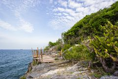 Bamboo fence on the cliff at Koh Sichang,Chonburi,Thailand. Stock Photography