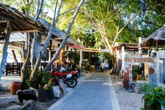 KOH TAO, THAILAND, Island life. A pedestrian street along the coast of Sayri beach is sometimes used by motorcycles