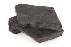 Kohle auf einem Weiß stockfoto