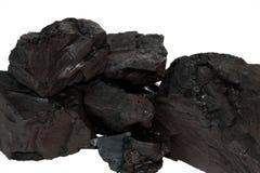 Kohle auf einem weißen Hintergrund Stockfotos
