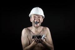 Kohlenbergmann auf einem schwarzen Hintergrund Stockfoto