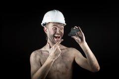 Kohlenbergmann auf einem schwarzen Hintergrund Lizenzfreies Stockbild