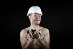 Kohlenbergmann auf einem schwarzen Hintergrund Stockbild