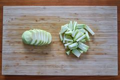 Kohlrabi Peeled Sliced And Chopped On A Vintage Bamboo Board stock photography