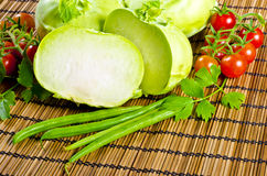 Kohlrabi, tomatoes and young peas Royalty Free Stock Photography