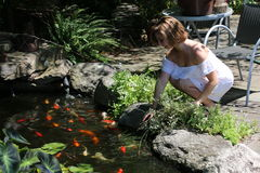 Koi Pond. Beautiful girl spends time at a koi pond Stock Images