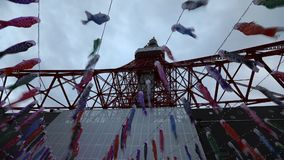 Koinobori at Tokyo Tower. Tokyo, Japan - April 23, 2017: bottom time lapse of colorful Koinobori at Tokyo Tower. Koinobori are carp-shaped wind socks stock footage