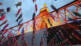Koinobori at Tokyo Tower. Tokyo, Japan - April 23, 2017: bottom view of Koinobori at Tokyo Tower by night. carp-shaped wind socks traditionally flown in Japan to stock video