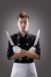 Kok met knifes, vooraanzicht het 3D teruggeven en foto Hoge Resolutie Stock Afbeeldingen