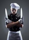 Kok met knifes, vooraanzicht het 3D teruggeven en foto Hoge Resolutie Stock Afbeelding