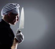 Kok met mes het 3D teruggeven en foto Hoge Resolutie Stock Foto's