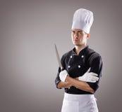 Kok met mes, vooraanzicht het 3D teruggeven en foto Hoge Resolutie Stock Foto's