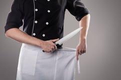 Kok met mes, vooraanzicht het 3D teruggeven en foto Hoge Resolutie Stock Foto