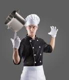 Kok met pan op vinger het 3D teruggeven en foto Hoge Resolutie Stock Foto