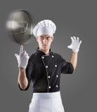 Kok met roterende dekking van de pan op vinger het 3D teruggeven en foto Hoge Resolutie Stock Fotografie