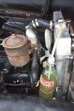 Koka-koli butelka używać dla przechować samochodowego kaloryferowego przelewu fluid obrazy royalty free