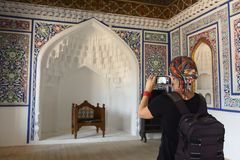 Kokand, Uzbekistan, Silk Route. Tourist admiring the Khudayar Khan Palace, the most popular landmarks of Fergana Valley, Kokand, Uzbekistan, Silk Route, khudoyar stock images