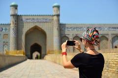Kokand, Uzbekistan, Silk Route. Tourist admiring the Khudayar Khan Palace, the most popular landmarks of Fergana Valley, Kokand, Uzbekistan, Silk Route, khudoyar stock image