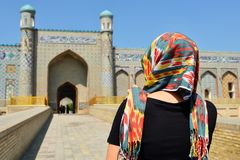 Kokand, Uzbekistan, Silk Route. Tourist admiring the Khudayar Khan Palace, the most popular landmarks of Fergana Valley, Kokand, Uzbekistan, Silk Route, khudoyar royalty free stock photography