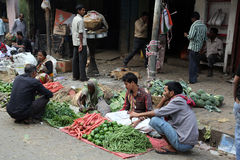 Kokata vegetable market. Street trader sell vegetables outdoor on February 11, 2014 in Kolkata India. Only 0.81% of the Kolkata`s workforce employed in the Stock Photography