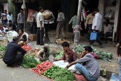 Kokata vegetable market. Street trader sell vegetables outdoor on February 11, 2014 in Kolkata India. Only 0.81% of the Kolkata`s workforce employed in the Stock Images
