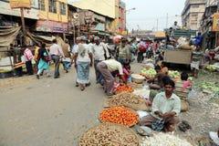 Kokata vegetable market. Street trader sell vegetables outdoor on February 11, 2014 in Kolkata India. Only 0.81% of the Kolkata`s workforce employed in the Royalty Free Stock Photo