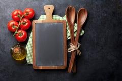 Kokende ingrediënten en werktuigen Stock Foto