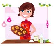 Kokende moeder die Kerstmiskoekjes voorbereidt Stock Foto