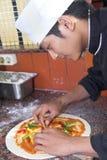 Kokende pizza Stock Afbeeldingen