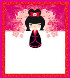 Kokeshi doll on the pink background Royalty Free Stock Photo