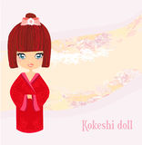 Kokeshi doll on the pink background Stock Photo