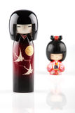 Kokeshi dolls. On white with reflection Royalty Free Stock Photo