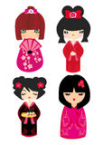 Kokeshi dolls in various designs isolated on white. Royalty Free Stock Images