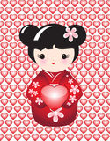 Kokeshi with heart Royalty Free Stock Photos