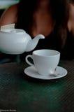Kokkärl och kopp te Royaltyfri Bild