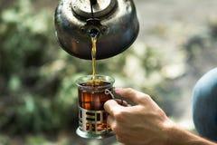 Kokkärl och kopp te Fotografering för Bildbyråer