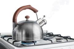 Kokkärl som kokar på en gasugn royaltyfri fotografi