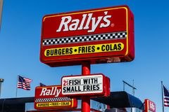Kokomo - Circa March 2018: Local Rally`s Drive Thru fast food restaurant. Rally`s is the sister of Checkers I. Local Rally`s Drive Thru fast food restaurant Stock Photography