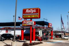 Kokomo - Circa March 2018: Local Rally`s Drive Thru fast food restaurant. Rally`s is the sister of Checkers II. Local Rally`s Drive Thru fast food restaurant Stock Images