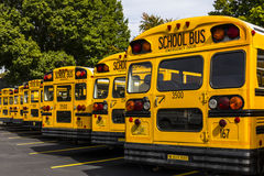 Kokomo - Circa October 2016: Yellow School Buses in a District Lot Waiting to Depart for Students VI. Yellow School Buses in a District Lot Waiting to Depart for stock photography