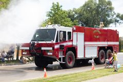 The Haynes Apperson Parade. Kokomo, Indiana, USA - June 30, 2018: Haynes Apperson Parade, A United States Air Force Fire Truck spraying the spectators with water stock image
