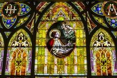Kokomo - vers en novembre 2016 : Verre souillé d'église dépeignant les anges et St Cecilia, le saint patron des musiciens II Images libres de droits