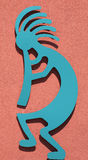 Kokopelli 2. Teal Kokopelli flute player against a red background Royalty Free Stock Images