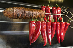 Kokorec And Some Sweet Red Peppers On A Skewer. Stock Images