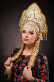 Kokoshnik. Girl Russian folk headdress and a length of a scythe Royalty Free Stock Images